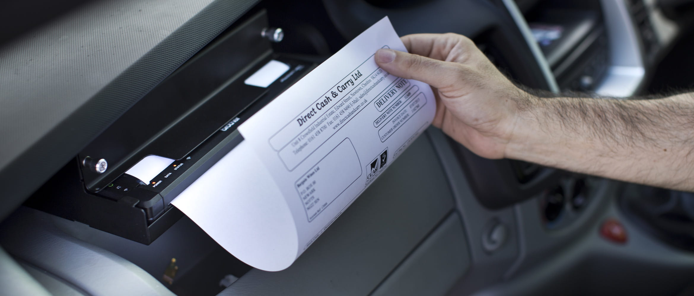 Man printing A4 document on PJ in vehicle mount
