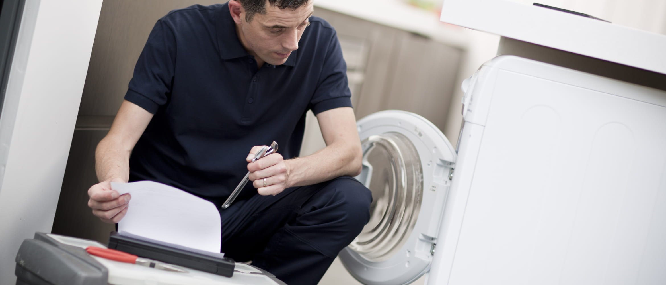 Man printing A4 document on PJ after fixing washing machine