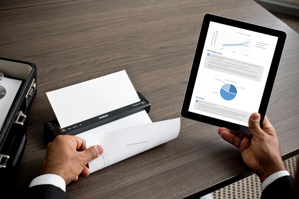 Man printing A4 sales report on PJ