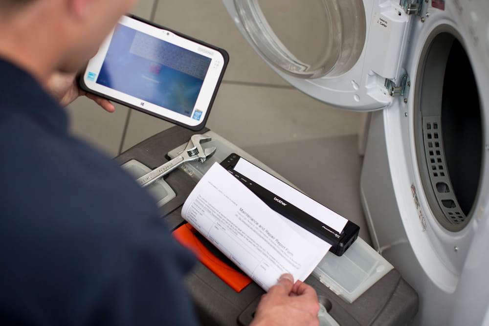 Man printing A4 document on PJ with tablet
