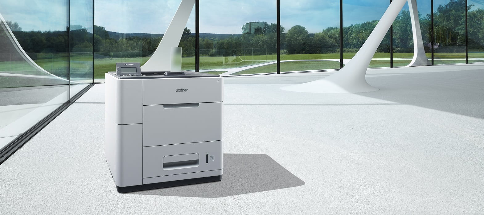 Stampante a tecnologia ibrida Brother HL-S7000DN in un ufficio openspace