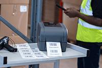 Stampante per etichette TD-4T sul carrello con scanner per stampare etichette