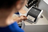 Brother TD-4520DN desktop label printer in hospital printing patient details label